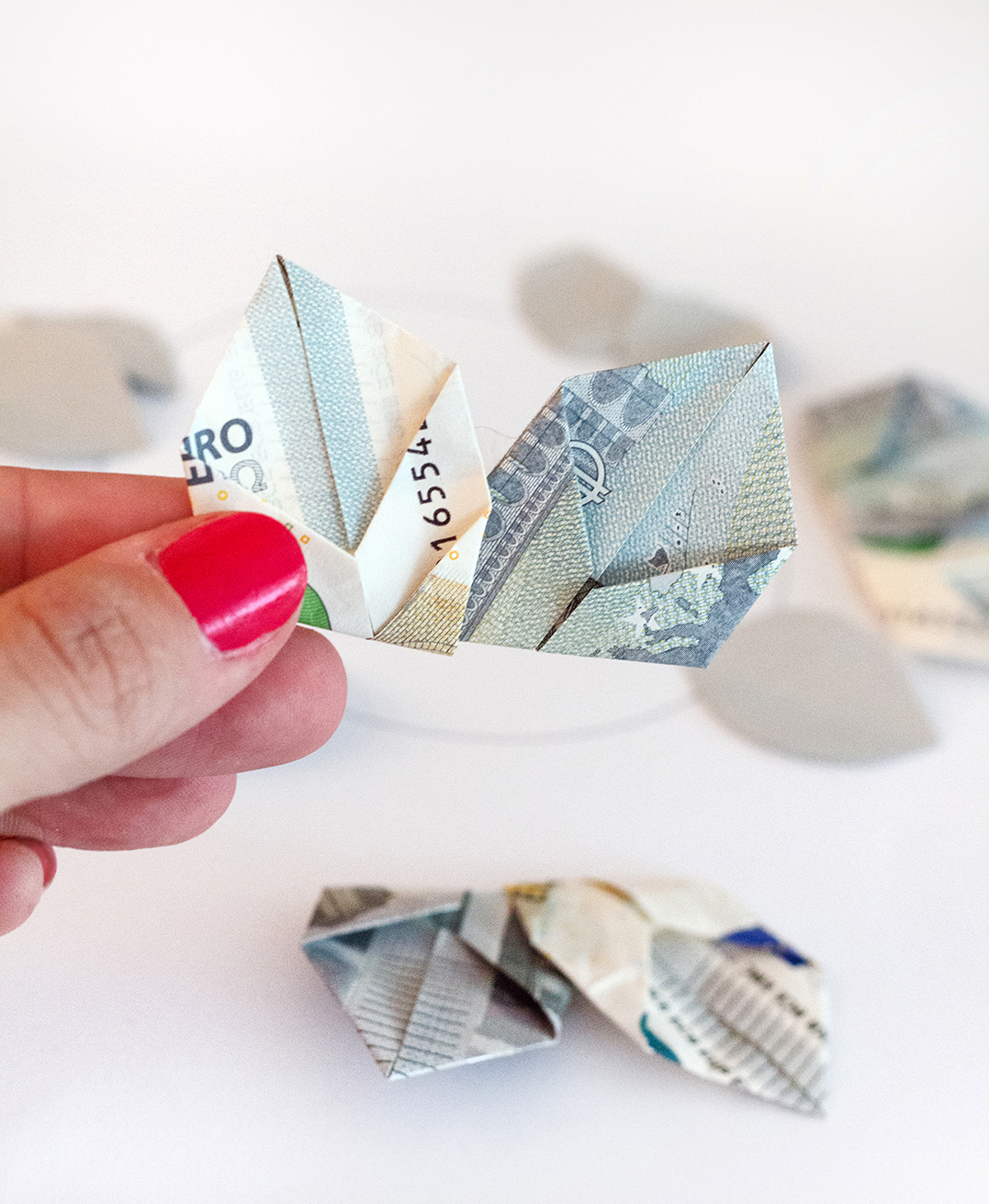 Geld falten Blätter